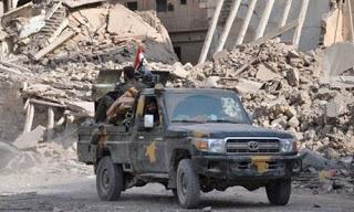 Suriye'de Irak Şam İslam Devleti'ne (IŞİD) karşı savaşan rejim güçleri, ülkede örgütün elinde kalan son şehir Elbu Kemal'i de geri aldıklarını açıklayarak, zafer ilan etti.