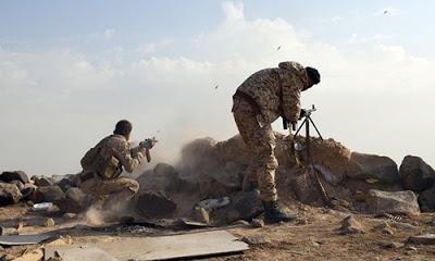 Suriye ordusu IŞİD'den ele geçirdiği silahları görüntüledi